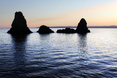 Sicily: Cyclopean Isles in Acitrezza at sunset. Stock Photo