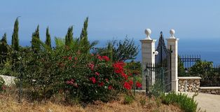Sicily. Flowers and gate in sicily Stock Image