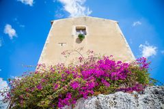 Sicily, Italy. Old house with purple flowers in Syracuse. Stock Image