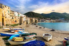 Sicily - old town Cefalu with fishing boats on the beach. Italy Stock Photos
