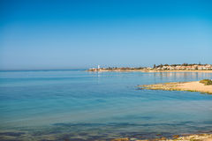 Sicily's south-west coast seascape. A calming seascape at Sicily's south-west coast with the lighthouse of Punta Secca on background Royalty Free Stock Images