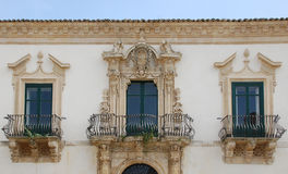 Sicily - Scicli. Typical Sicilian baroque balcony Royalty Free Stock Image