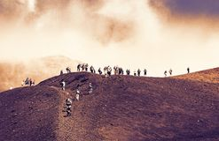 Sicily sunset, people walking on Mount Etna, active volcano stock photography