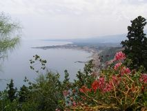 Sicily Taormina Mediterenian View From Giardini Della Villa Communale Towards Naxos royalty free stock images