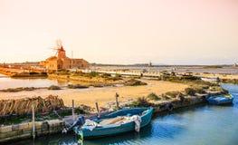 Sicily, Trapani wind mill sea salt production, Italy. Royalty Free Stock Photos