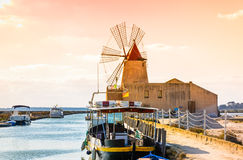 Sicily, Trapani wind mill sea salt production, Italy. Royalty Free Stock Photo