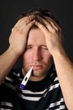Sick adult. Person with a cold. Isolated on black Stock Photos