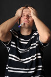 Sick adult. Person with a cold. Isolated on black Stock Image