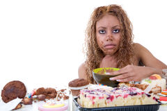 Sick as a dog. Pretty black girl feeling very ill after having eaten too much sweets Royalty Free Stock Photography