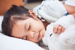 Sick asian child girl sleeping in the hospital. Sick asian child girl is sleeping in the hospital stock photo