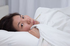 Sick asian girl Royalty Free Stock Images