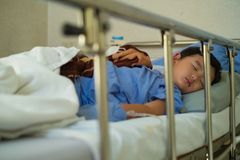 Sick Asian kid boy 2 years old lying sick in hospital bed. Selective focus stock photos