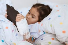 Free Sick Asian Little Child Girl Using Digital Tablet Royalty Free Stock Image - 110588036