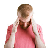 Sick bearded man holding his head Stock Photo