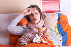 Sick in bed Stock Images