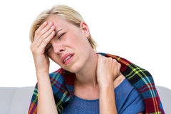 Sick blonde woman having both headache and neck pain Royalty Free Stock Photo