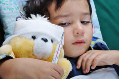 Sick boy. With his toy Stock Images