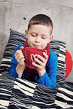 Sick boy. 9 years old boy sick in bed - kids and family royalty free stock photos