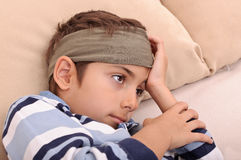 Sick boy in bed Royalty Free Stock Image