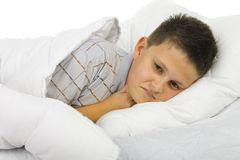 Sick boy in bed Stock Images