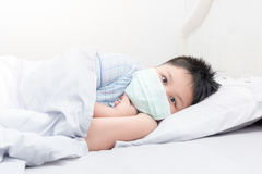 Sick boy with hygienic mask royalty free stock photography