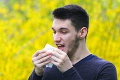 Sick boy with polen allergy  is sneezing. Boy with polen allergy  is sneezing in the park Royalty Free Stock Photos