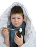 Sick boy with a  thermometer Royalty Free Stock Photography