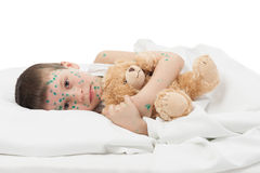 Sick boy in white bed Royalty Free Stock Photography