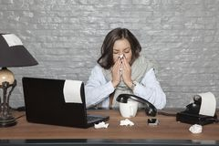 Sick business woman blows into a tissue. Portrait of a business person Royalty Free Stock Image