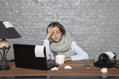 A sick business woman can not focus on work. Portrait of a business person royalty free stock photo