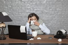 Sick business woman, constantly flying from the nose. Portrait of a business person Royalty Free Stock Image