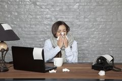 Sick business woman, devotes her health to work. Portrait of a business person Royalty Free Stock Image