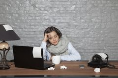 Sick business woman is dozing at the desk. Portrait of a business person royalty free stock photo