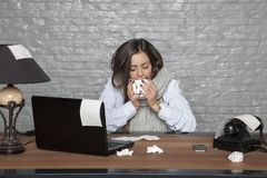Sick business woman drinking a hot drink. Portrait of a business person Stock Image