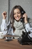 Sick business woman is gossiping on the phone. Portrait of a business person Stock Image