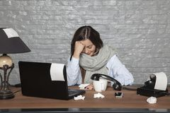 A sick business woman is not able to work. Portrait of a business person Stock Photography