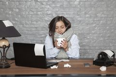 Sick business woman shakes from cold. Portrait of a business person Stock Photography