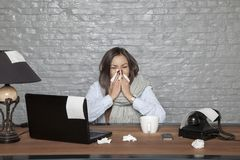 Sick business woman, tissues around the desk. Portrait of a business person Stock Image