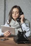 Sick business woman is watching something on the tablet and talk. Ing on the phone, portrait of a business person Royalty Free Stock Photo