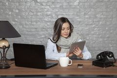 Sick business woman writing down on a message. Portrait of a business person Stock Image