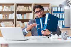 The sick businessman suffering from illness in the office Stock Photography