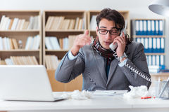 The sick businessman suffering from illness in the office Stock Photo