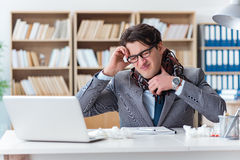 The sick businessman suffering from illness in the office Royalty Free Stock Image