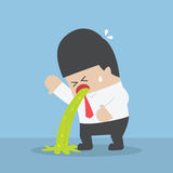 Sick businessman vomiting. On the floor Royalty Free Stock Images