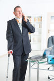 Sick businessman at work Stock Photo