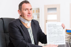 Sick businessman at work Royalty Free Stock Photo