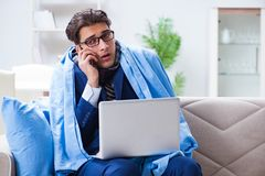 The sick businessman working from home due to flu sickness. Sick businessman working from home due to flu sickness Royalty Free Stock Photo