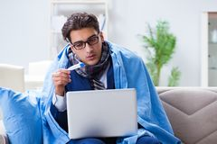 The sick businessman working from home due to flu sickness. Sick businessman working from home due to flu sickness Stock Image
