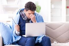 The sick businessman working from home due to flu sickness. Sick businessman working from home due to flu sickness Royalty Free Stock Photography