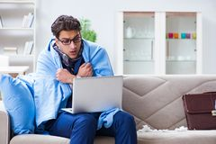 The sick businessman working from home due to flu sickness. Sick businessman working from home due to flu sickness Stock Images